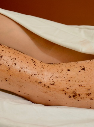 Arm attached to the body, covered with body exfoliation product